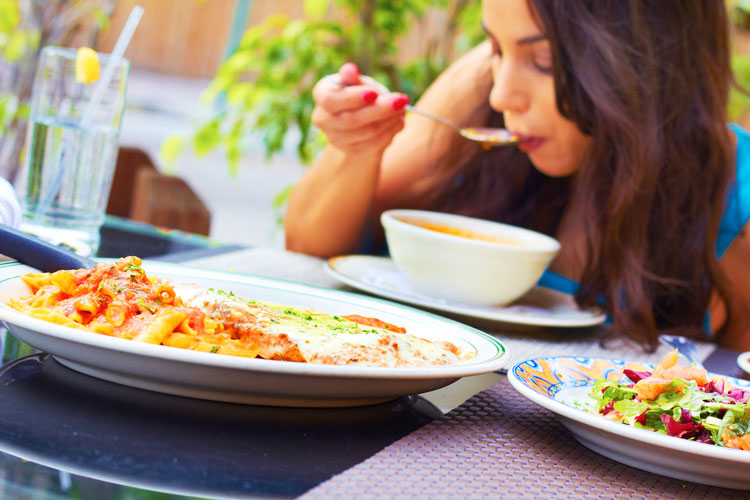 Young woman comfortably eating meal