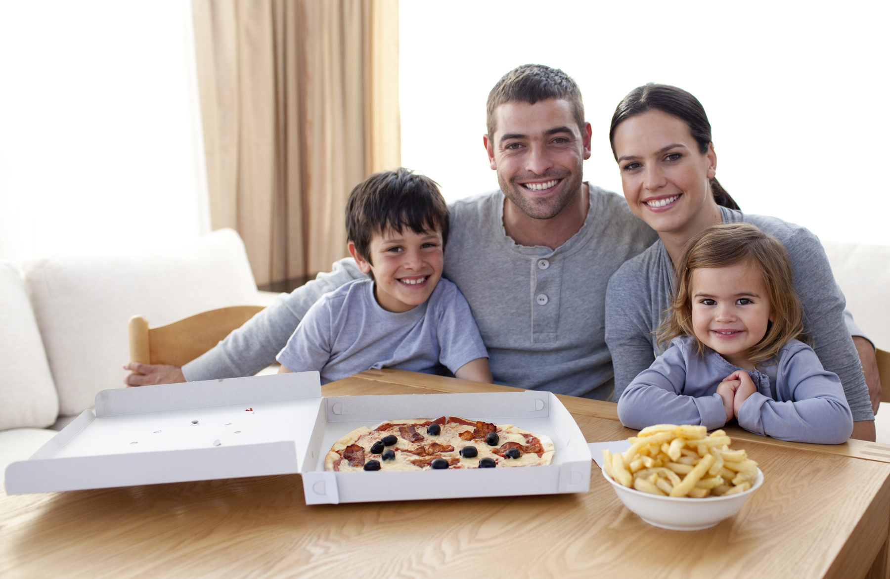 Family Eating Pizza And Fries At Home | Ellyn Satter Institute